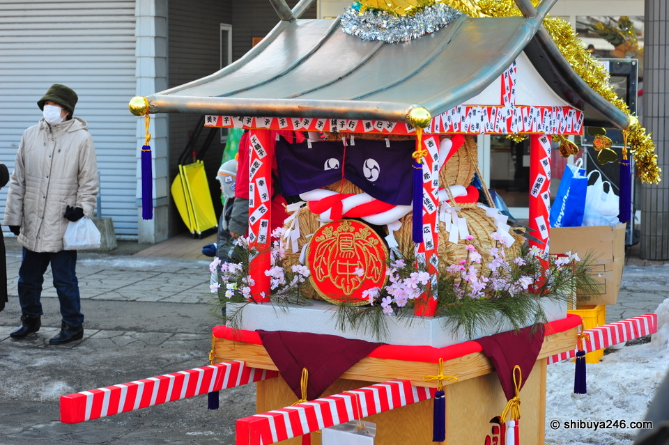 A portable shrine getting ready to be shown in the parade.
