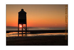 Orange Glow (Winterspeak) Tags: wood uk winter light sunset red sea england sky orange sun lighthouse white house reflection english beach water silhouette yellow horizontal set century reflections landscape gold golden evening coast march wooden spring sand europe skies legs britain dusk timber painted united low nine great north silhouettes 9 kingdom sunny somerset clear reflected coastal gb pilings setting silhouetted burnham 19th active 2010 nineteenth