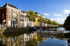 Picture of Leiden (Fabi Fliervoet) Tags: travel blue summer sky motion reflection tourism netherlands dutch clouds buildings boat leiden tour ditch bright traditional stock thenetherlands tourist canals zuidholland fabifliervoet
