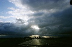Driving West (Mark Waldron) Tags: sky west film clouds zeiss 35mm driving fuji rangefinder contax g2 45mm 100asa reala sunbeams planar
