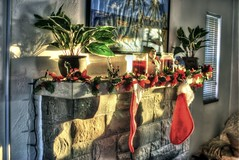 """""""Most folks are about as happy as they make up their minds to be."""" (Dave DiCello) Tags: christmas decorations sunset sun stockings photoshop lights nikon dusk tripod nikkor hdr highdynamicrange mantle cs4 photomatix d40 tonemapped d40x"""