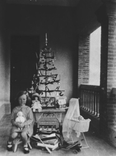 Christmas morning under the Christmas tree, ca. 1935