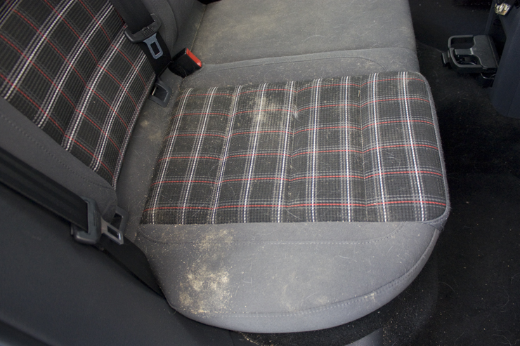 Cloth seats with sand and dog hair