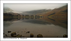Reflections at Buttermere (Dave Brightwell) Tags: mountains water beautiful clouds sunrise landscape boat scenery rocks district jetty sony lakes scenic hills derwentwater keswick catbells buttermere a550