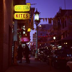 kites for sale! (jillysp) Tags: sanfrancisco california 6x6 mamiya night mediumformat neon fuji kites velvia bunting 80mm c330f