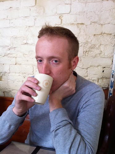 an unusual but gorgeous ceramic latte glass as modelled by a man of the same calibre