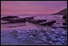 ROCK FORMATIONS (IMAGES OF WALES.... (TIMWOOD)) Tags: pink sunset sea wales coast rocks purple sony pebbles filter slowshutter alpha valeofglamorgan bridgend southerndown bristolchannel unusualrocks a700 dunravenbay colorphotoaward unusualrockformations
