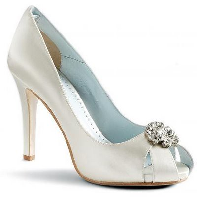 Wedding shoe with a decorative brooch.