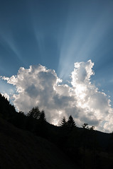 Evening sun rays shining through the clouds (Horia Varlan) Tags: blue trees light sky sun clouds forest evening hills rays