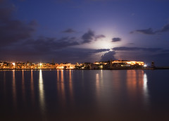 Moon hiding (Theophilos) Tags: sea sky moon reflection night clouds lights greece crete hiding rethymno fortezza