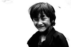 Incontri col Sorriso (sgrazied) Tags: light portrait blackandwhite bw travelling smile childhood kids children peace bhutan bambini rimini canoneos20d innocence pace oriente sorriso ricordi ritratto freetibet biancoenero povertà romagna bambina sorrisi visi viaggiare innocenza buddismo preghiere sgrazied interphoto stenti aprile2008 indiaebhutan