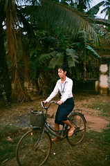 (NateVenture) Tags: road travel school color film girl bike bicycle kid cambodia rep angkorwat negative pointandshoot phnompenh konica s400 siemreap superia400 500yen pns   bigmini highway6 superiaxtra400 pnh  bm302    ncps   nationalhighway6 northcoastphotographicservices stuckinauto droppedbychris
