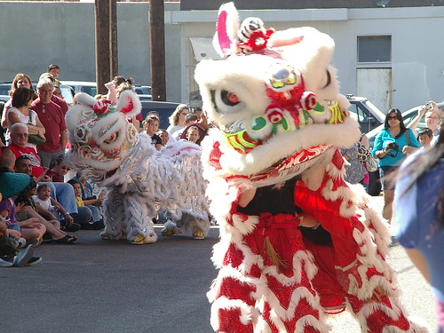 red and white lion dancers