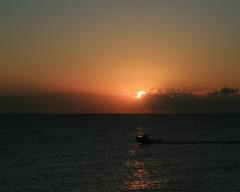 Beautiful Boat Ride (Mark Jaxn) Tags: ocean morning sun west beach beautiful sunrise boat early florida calm palm rise markjackson markjaxn jaxnphotography