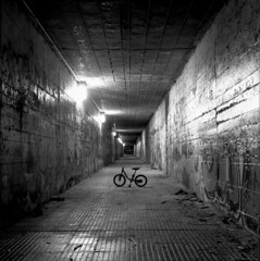 (Andrs Medina) Tags: longexposure blackandwhite bw slr byn 120 6x6 blancoynegro film lines childhood bicycle night analog mediumformat children vanishingpoint rainyday darkness expo perspective streetphotography tunnel bicicleta bronica inside acros100 bronicas2 fujiacros100 zenza autaut artlibres andresmedina seleccionfnac