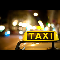 Taxi (Ben Fredericson (xjrlokix)) Tags: street city wallpaper urban car sign night germany 50mm lights nikon nacht bokeh f14 taxi text creative free commons cc german hd af 1920 blinking 1080 ipad fullhd
