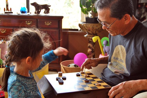 a game of checkers with her Lolo