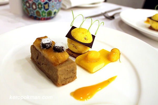 "Almond Biscuit with Chocolate Banana Ice Nougat and Mango ""Bomb"" in Passion Fruit Snow Jelly Wrap"