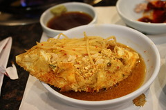 Rice stuffed into the crab with sprouts