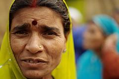 pilgrim | Kolkata (arnabchat) Tags: light portrait woman india color green face closeup lady eyes dof veil bokeh double kolkata bengal calcutta bangla westbengal 50f18 pigrim arnabchat arnabchatterjee gangasagartransitcamp kwsgangasagarcamp110109