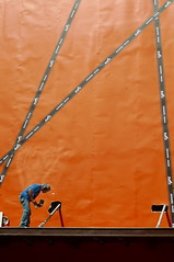 paint the town orange (.emong) Tags: street city blue urban orange shop lumix philippines panasonic painter worker makati job hermes ayalacenter lx3