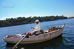 The Merchant Of The Nile.. (SonOfJordan) Tags: trip travel blue sky colour water canon river eos boat egypt row nile egyptian merchandise local merchant xsi nubian felluca 450d samawi sonofjordan canoneosxsi450dsamawisonofjordan wwwshadisamawicom