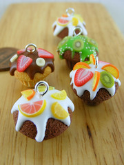 Assorted Cupcake Pendants (Shay Aaron) Tags: food orange cute ice cake fruit miniature berry handmade aaron cream fake mini jewelry banana polymerclay fimo slice tiny pastry faux shay grapefruit vanilla muffin kiwi  frosting geekery jewel petit frosted          citus                 shayaaron wearablefood