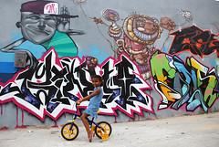 Vila Operria/RJ (Rato Diniz) Tags: muro brasil riodejaneiro pose cores graffiti mural rj arte grafiti retrato bicicleta garota criana menina periferia cor novembro favela 2009 morro desenho caxias parede jovem pintura painel criao juventude grafite artederua comunidade colorido voluntariado duquedecaxias criatividade mof solidariedade arteurbana jovens graffite voluntrio digitalcameraclub mutiro comunidadepopular grafiteiro espaourbano rato solidrio espaopopular ratodiniz vilaoperria linguagempopular meetingoffavela meentingoffavela morrodavilaoperaria novembrode2009