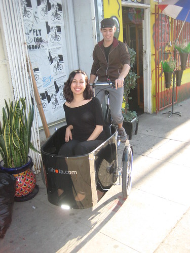 Jon, shop manager of Flying Pigeon LA, riding a Nihola Family with his lunch date in the front.