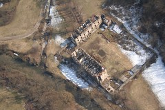 Ruins near the town of Malnate (_ Night Flier _) Tags: above city travel sky italy panorama snow green rooftop nature airplane landscape town flying high view earth top aviation ruin aerial fromabove lombardia varese cessna skyview lombardy birdeye aeronautic malnate