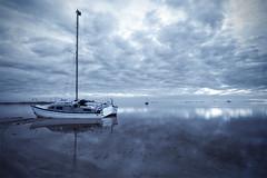 Azul calma (José Andrés Torregrosa) Tags: clouds marina canon barco amanecer nubes marmenor calma 2010 joseandres losurrutias nohdr cianotipo 40d tokina1116