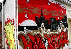 Red Sky Over Toronto (Georgie_grrl) Tags: b red sky streetart toronto ontario flower face skyline clouds graffiti cntower head expression creative photographers social pentaxk1000 skydome colourful doves baseballcap loveyoudad torontophotowalk cans2s rikenon12828mm topwbv kalidreamz