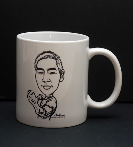 guy caricature in ink on mug
