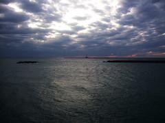 Tramonto sbiadito -  Faded sunset. (sinetempore) Tags: light sea cloud sun lighthouse water faro mare nuvola sole acqua salento luce galliopoli