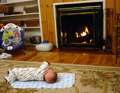 baby watching the fireplace