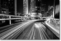 Travelling Light (fotokei) Tags: longexposure light blackandwhite bw architecture night buildings hongkong skyscrapers traffic sony central wide wideangle ifc ifc2 internationalfinancecentre 1118mm ifc1 a550 alpha550