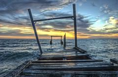 Elwood Jetty (J-C-M) Tags: sunset reflection beach water clouds photoshop bay pier nikon jetty bracket d70s wave australia melbourne victoria bayside elwood topaz portphillip 3xp photomatix elwoodbeach tonemapped topazdetail
