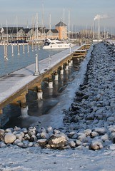 marina walkway (MatiasSingers) Tags: ocean winter snow cold ice water sunshine marina boats boat frozen freezing iced