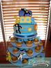 Noah's Ark (SweetnessBakeshop) Tags: blue elephant cakes animals yellow monkey boat cupcakes purple miami lion bakery zebra giraffe babyshower noahsark 305 fondant buttercream gumpaste