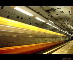 at lightning speed (sediama (break)) Tags: red rot yellow metal speed germany subway geotagged essen metro pentax flash gelb ubahn metall geschwindigkeit abigfave k20d kaiserwilhelmpark sediama pentaxart bestofmywinners igp7669 ©bysediamaallrightsreserved