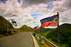 Philippines' Pride (Don Maurius) Tags: road canon eos chocolate flag philippines hills bohol carme 40d