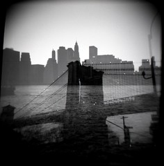 east river double exposure (citycrab) Tags: nyc bridge bw water skyline brooklyn river holga doubleexposure manhattan brooklynbridge eastriver gothamist