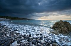 'Sunset Over Black Point' - Penmon, Anglesey (Kristofer Williams) Tags: sunset sea seascape beach rain clouds waves shoreline coastline storms cloudscape blackpoint anglesey rainshowers penmonpoint