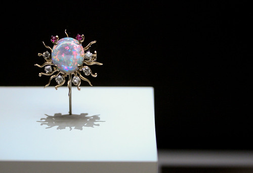 black opal, diamonds and rubies set in gold brooch