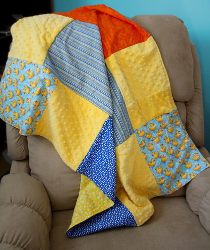 Ducks in a row Baby Blanket