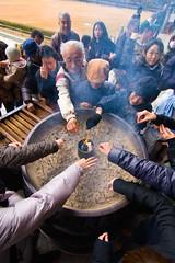 Gathered round the incense at Todai-ji, Nara (cameranew) Tags: travel pink girl japan canon japanese interesting kyoto asia candid traditional contest january culture 85mm vivid worldheritagesite tokina kimono arrow colourful archery f18 nara sanjusangendo f28 narapark 40d hannyaji 1116mm ebmarrassed