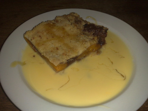 plum and peach crumble with custard