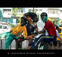 Colourful Smiles (Jogeshwar) Tags: red india playing men green boys yellow festival youth lens happy spring nikon colours afternoon celebrations 1855 nikkor holi kolkata calcutta celebrating youngmen abir indianfestival jogeshwar gulal d3000 nikond3000