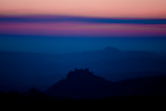 Carreg Cennen Silouhette Sunset 07.03.10 Edit 1 (Gareth Scanlon) Tags: blue trees sunset orange cliff cloud sun black blur detail tree castle nature yellow clouds haze carmarthenshire cloudy highcontrast bluesky medieval breconbeacons burningsky sharpen uphill legend barren beacon blackmountain rugged beautyspot sunray watcher enclosure castell desaturate cliffface carmarthen shutterpriority longshutterspeed ammanford castellcarregcennen polarisingfilter brynamman naturewatcher gwauncaegurwen orangeraduatedfilter