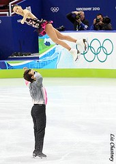 Shen and Zhao's huge split triple twist during their Olympic short program (Photo by Liz Chastney)